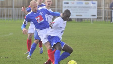 Action from the local derby: David Head keeps a close eye on Emmanuel Osei