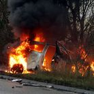 A woman was dramatically resced from a burning car seconds before it exploded in a ball of flames. T