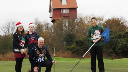 Thorpeness gets in the festive swing for a good cause. Left to right: Thorpeness Hotel staff members
