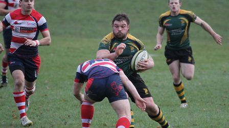Bury's Beau Gibson runs at the Dorking defence