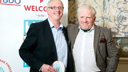 Adam Brown,chief financial office at Access Group, left, receiving his Hot 20 FD in TMT award from