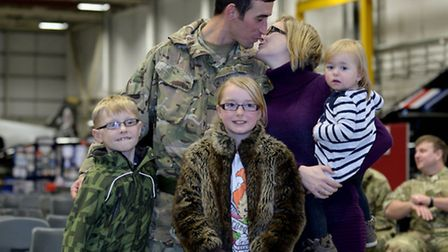 Air Trooper Michael Moran (27) from Southampton with wife Gemma, with wife Gemma holding Jessica (19