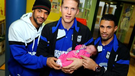 ITFC players visit West Suffolk Hospital's Rainbow Ward to give out Christmas gifts. Left to right D