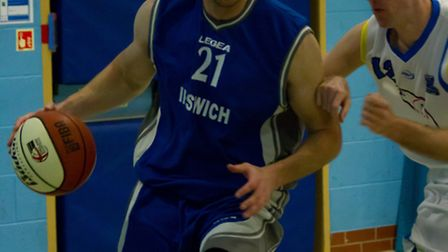 Ipswich captain Tom Sadler on the drive against Mansfield