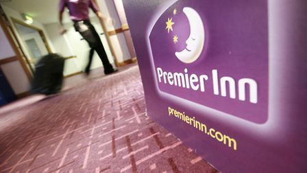 Whitbread is to open 500 fewer new Premier Inn rooms this year than previously planned.