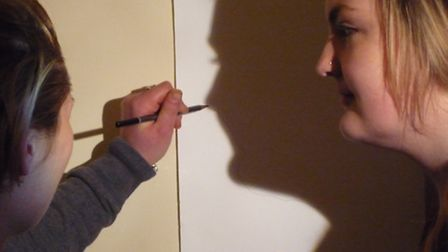 Two young adult carers trace shadows in Suffolk Artlink's Exchanges 2 Photo Credit: copyright: S