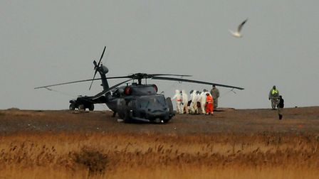 Bodies are recovered from the USAF helicopter crash in Cley