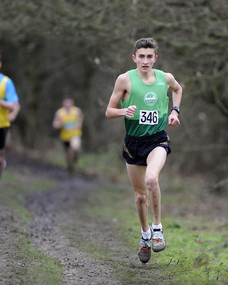 Jordan Rowe on his way to comfortably winning the Under 17 men's race at Hilly Fields