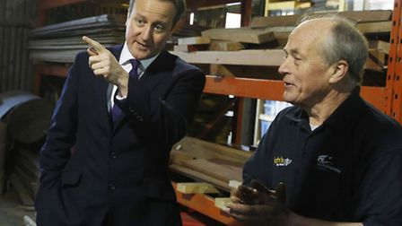 Prime Minister David Cameron speaks with boat builder and restorer John Watson during a visit to sma