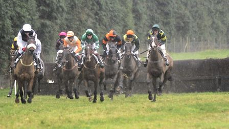 Riders make a jump during the second race at the North Norfolk Harriers Point-to-Point race at Higha