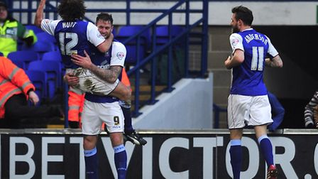 Stephen Hunt leaps on Daryl Murphy after the latter put Ipswich 1-0 up against Reading. PHOTO: Lucy