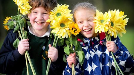 Hamish Miller and Isabelle Tee from St Edmundsbury Primary School with their sunflowers at the launc