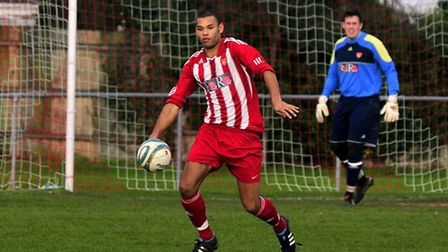Dan Davis (on the ball) has been in fine form at the heart of Felixstowe's defence this season