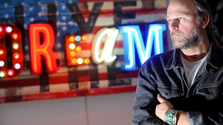 Chris Bracey has been producing neon artwork using wood he salvaged from historic buildings in Thorp