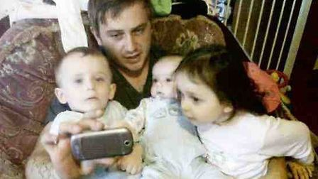 Dad Craig McLelland with his three children Addy, two, Kyden, 11 months, and Levina, three. Picture: