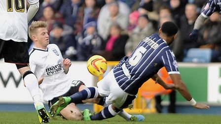 Luke Hyam launches himself into a challenge with Millwall's Liam Trotter which resulted in him being