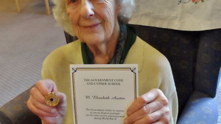 Liz Austin with her Bletchley Park Commemorative Badge and certificate