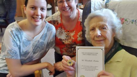 Right to left: Liz Austin, of Framlingham, with her Bletchley Park Commemorative Badge and certifica