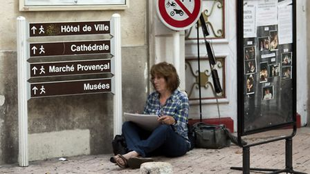 Suffolk artist Anne Rea, pictured sketching in Antibes, will be exhibiting at Woodbridge Library in