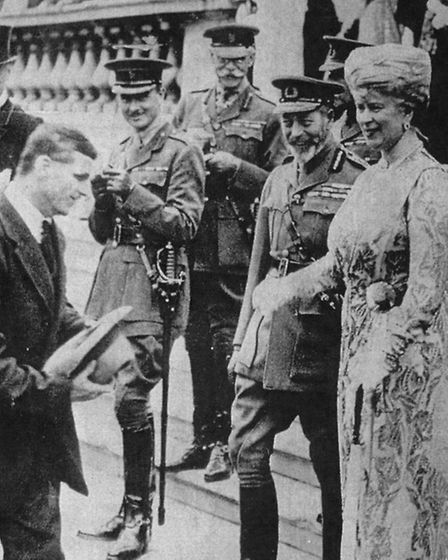 Private Samuel Harvey (Left) at Buckingham Palace Garden Party 1919. Pictured with George V and Quee