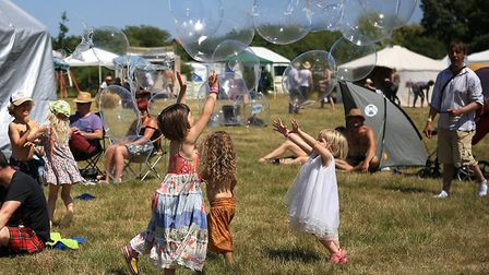 Something for everyone at Wow festival - children enjoy bubble-blowing in the sun. Picture: Jerry Ty