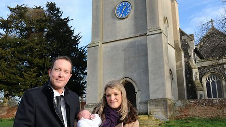 Ollie Porter and Helen Seaton are pictured with Jack Porter for his christening at Ickworth Church.