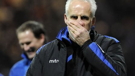Mick McCarthy is unhappy at Deepdale, while opposite number Simon Grayson is full of smiles