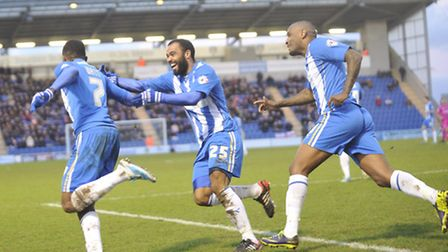 Colchester celebrate after Sanchez Watt scores the team's first goal in the game.