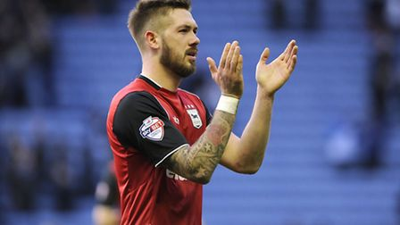 Luke Chambers applauds the travelling fans after the defeat at Leicester