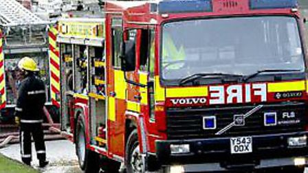 A man and woman were rescued from a vehicle which was stuck in a ditch