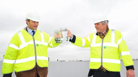 Waveney MP Peter Aldous and Dr Simon Lyster of the Northumbrian Water Group perform the topping out