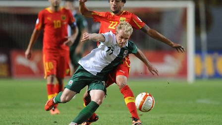 Crystal Palace midfielder Jonathan Williams (foreground) in action for Wales against Macedonia