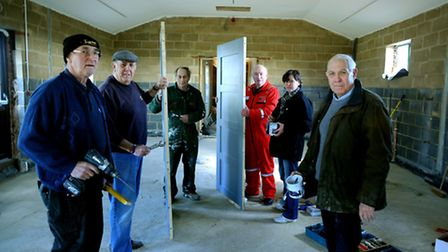Volunteers show off work at the new extension to Parham Airfield Museum - Michael Spink, Tim Brett,