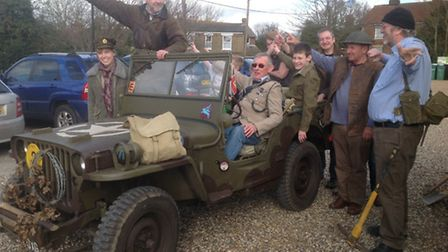 Supporter of the Colne Engaine War Memorial project in the Jeep they intend to use for the jail brea