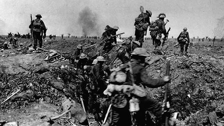THE SOMME: British troops negotiate a trench as they go forward in support of an attack on the villa