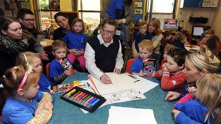 Beano artist Barrie Appleby at Acton Pre-School teaching the children to draw cartoon characters