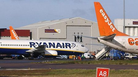 Ryanair and easyjet planes on the ground at Luton Airport.