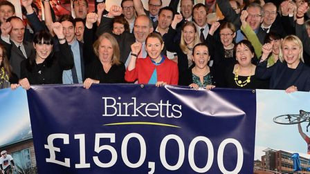 Members of the Birketts team in Ipswich celebrate the firm's fundraising success during its annivers