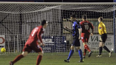 Felixstowe and Walton players start to celebrate after Miles Powell's strike hits the net against Ne
