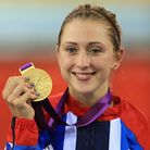 Great Britain's Laura Trott celebrates with her Gold Medal for the Women's Omnium in the Velodrome a