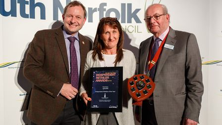 Janet Harrowven picks up the award from council leader John Fuller and deputy chairman Garry Wheatle