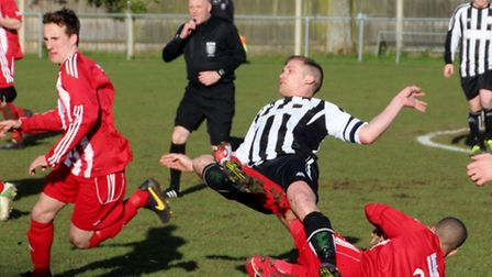 Tom Deller (black and white) getting stuck into the thick of the action against his former club