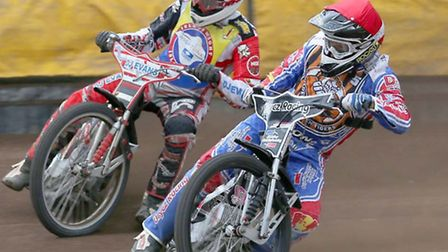Mildenhall's Dan Halsey (red) inside Tom Perry (white) last year in the clash between Mildenhall and
