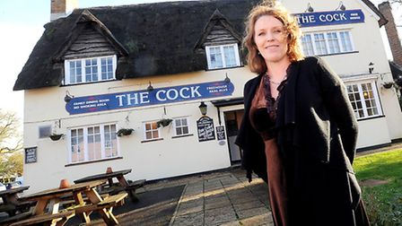 Neighbours are upset because The Cock pub is replacing its thatched roof with tiles. Pictured is lan