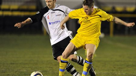 The Touchline Suffolk and Ipswich League's Juddy Chenery (left) of Wenhaston United battles for poss