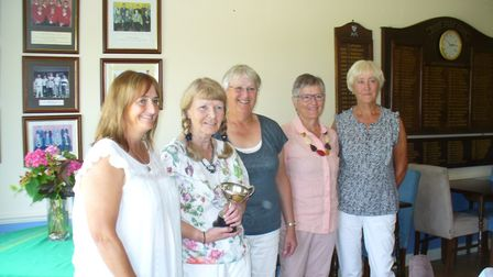 Picture from left to right at Diss Golf Club are Becky Draper, Liz Speak with winners' trophy, Jenn