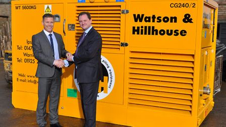 Phil Bell, left, managing director of Watson & Hillhouse, receiving the keys to a BSP power pack, p