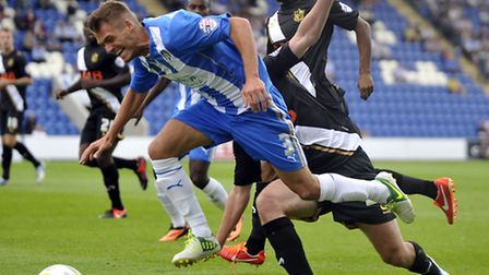 Ryan Dickson, in action against Port Vale, who are set to host Colchester United tomorrow