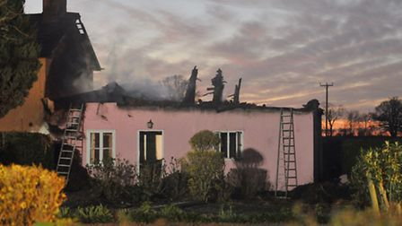 Firefighters at the scene of a thatched house fire in Whissington.