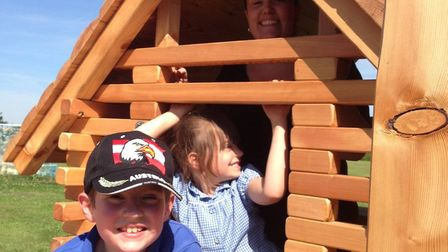 A family enjoys using the newly installed play equipment at Palgrave playground. Picture Hannah Cook